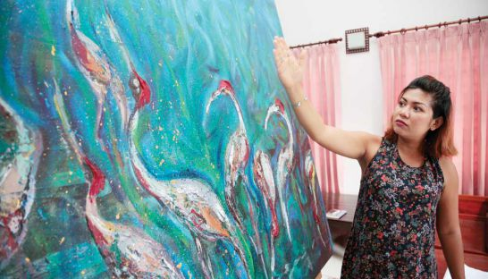 Cambodian Artists Khmer Female Artist Dina Chhan Painter and Sculptor in her studio in Phnom Penh